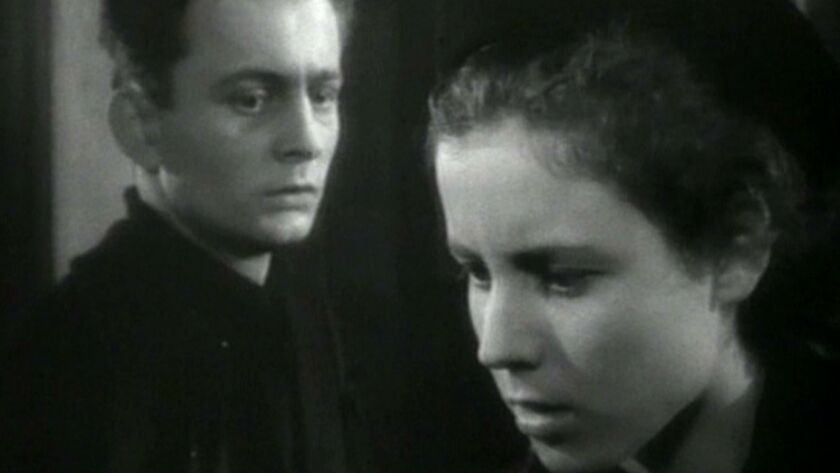 "Claude Laydu and Nicole Ladmiral in Robert Bressons movie ""DIARY OF A COUNTRY PRIEST"" (1951). Photo"