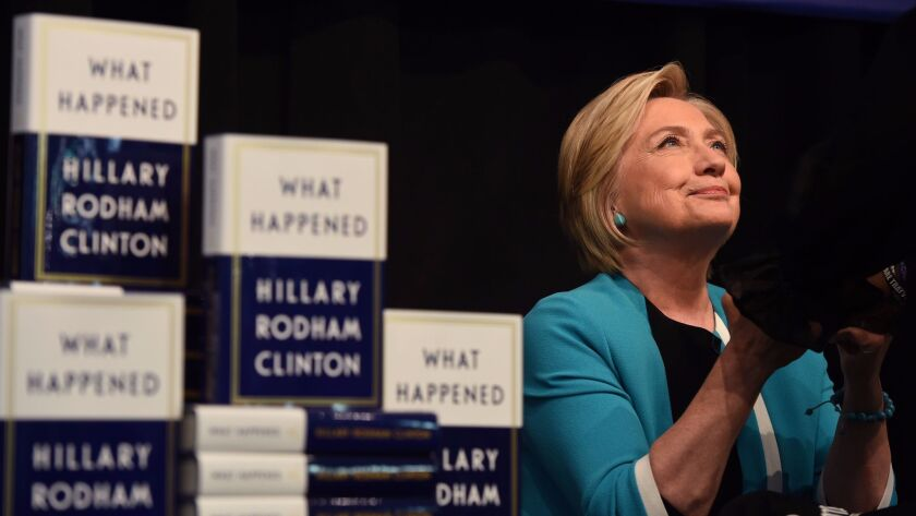 """Hillary Clinton signs """"What Happened"""" in New York on Tuesday."""
