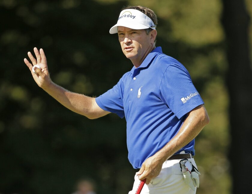Davis Love III waves to the crowd on the 18th hole during the final round of the Wyndham Championship golf tournament at Sedgefield Country Club in Greensboro, N.C., Sunday, Aug. 23, 2015. Love won the tournament. (AP Photo/Chuck Burton)