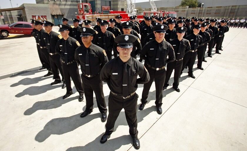 The 58 latest recruits of the Los Angeles Fire Department stand in formation during their graduation ceremony in Panorama City in June.