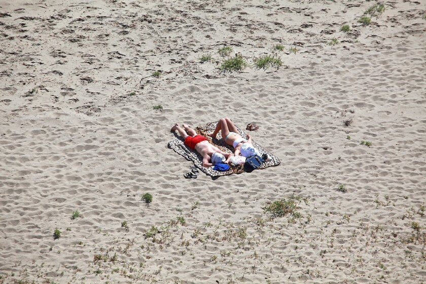Sunbathers soak up ultraviolet rays at La Piedra State Beach in Malibu. A new report from the CDC says that the incidence of melanoma -- the most deadly form of skin cancer -- has doubled in the U.S. in the last 30 years.