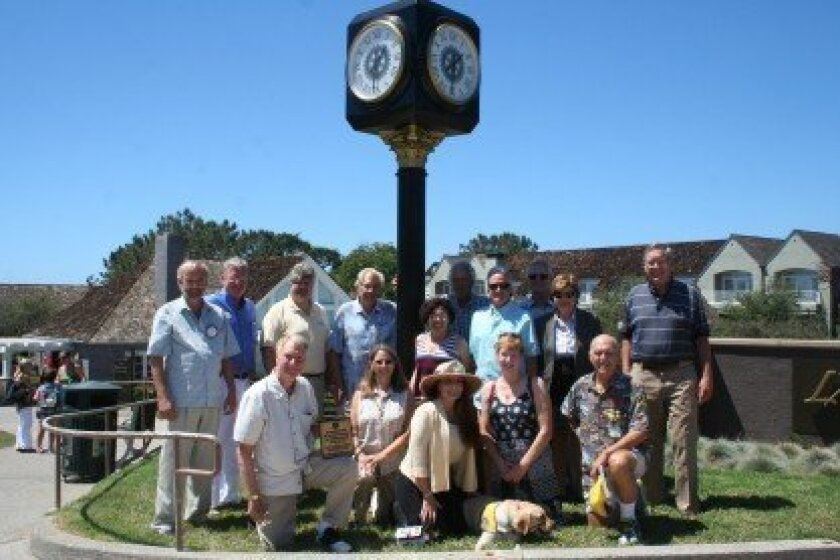 Members of the Del Mar Rotary with the refurbished clock. 'Someone from Rotary will always be here to take over and manage it,' says Rotarian Marty Peters. Photo by Kristina Houck