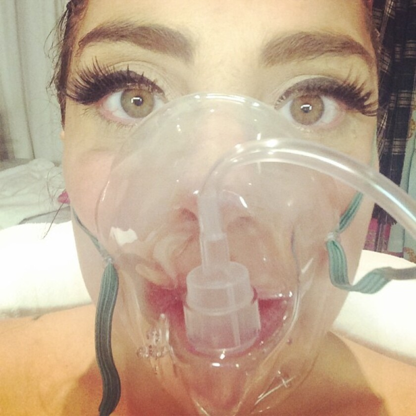 Lady Gaga said she had to go to the hospital in Denver because of altitude sickness.
