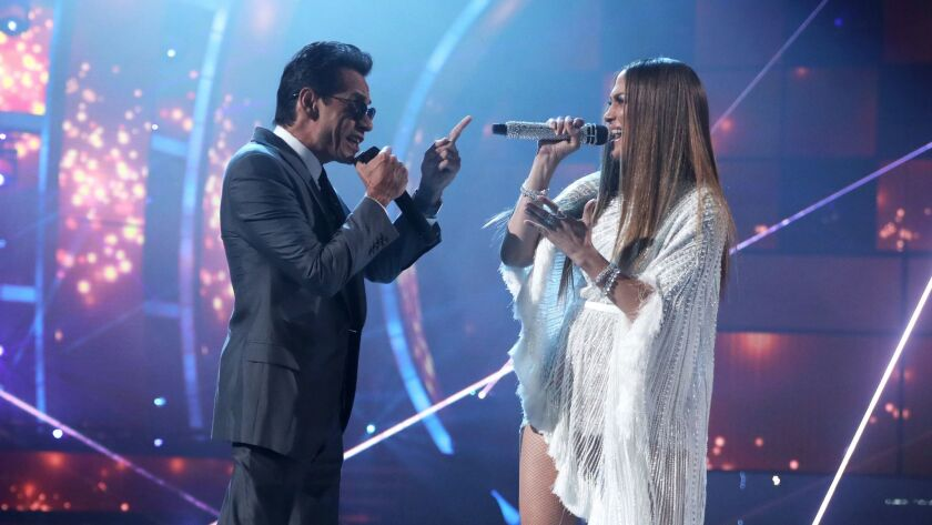 "Marc Anthony and Jennifer Lopez perform the Pimpinela song ""Olvídame y Pega la Vuelta"" — about a breakup."