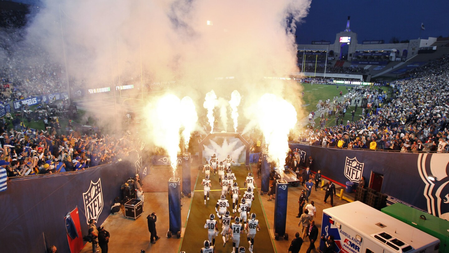 The Los Angeles Rams take the field before a game against the Atlanta Falcons at the Los Angeles Coliseum on January 6, 2018. (Photo by K.C. Alfred/ San Diego Union-Tribune)