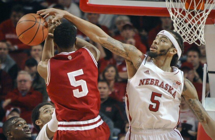 Nebraska guard/forward Terran Petteway (5) gets a block against Indiana forward Troy Williams (5) during an NCAA college basketball game, Thursday, Jan. 30, 2014 in Lincoln, Neb.(AP Photo/Dave Weaver)