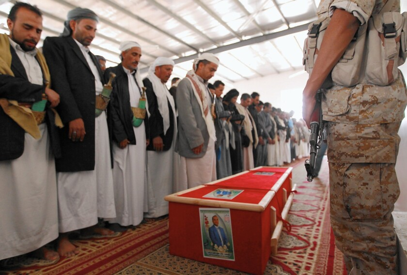 Yemenis pray for Bashar Arhab, one of the victims of the March suicide bombings at two Shiite mosques in Sana, the capital.