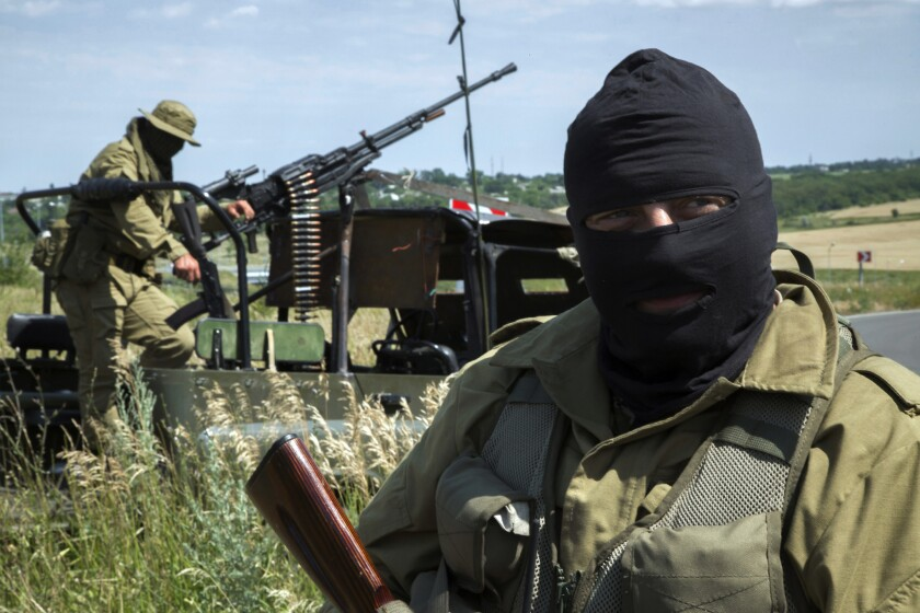 Pro-Russia fighters guard an antiaircraft position near Luhansk in eastern Ukraine on Wednesday as government troops waged a broad offensive against the separatists.