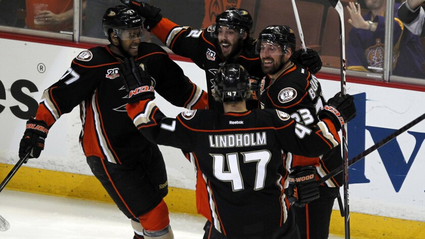 Ducks teammates celebrate a goal by Devante Smith-Pelly, far left, during the second period of the team's 4-3 win over the Kings in Game 5 of the Western Conference semifinals at Honda Center on Monday.