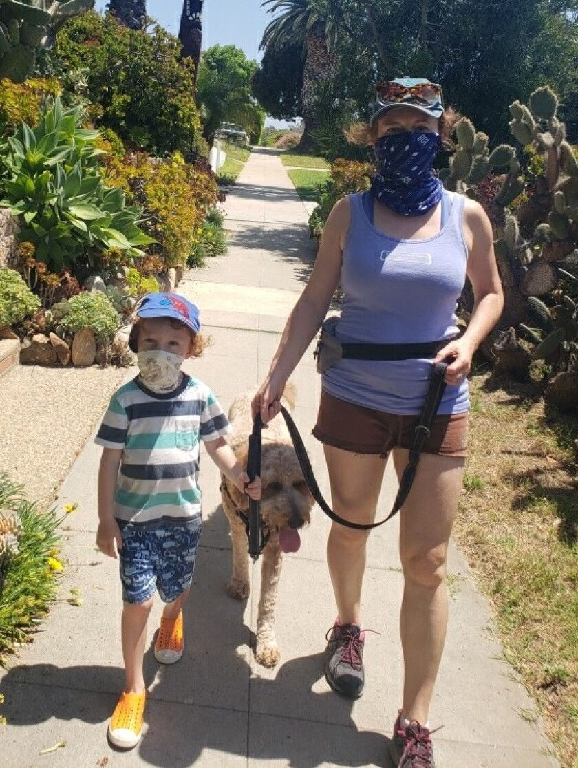 Mira Rubin and her son walk one of the furry clients of Rubin's Paradise Pet Care.
