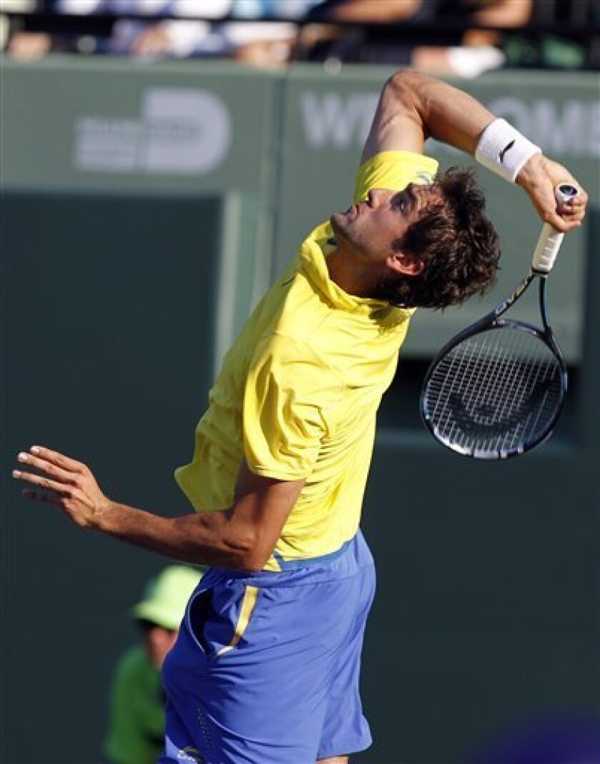 Marin Cilic of Croatia serves to Juan Martin Del Potro of Argentina at the Sony Ericsson Open tennis tournament, Monday, March 26, 2012, in Key Biscayne, Fla. (AP Photo/Lynne Sladky)