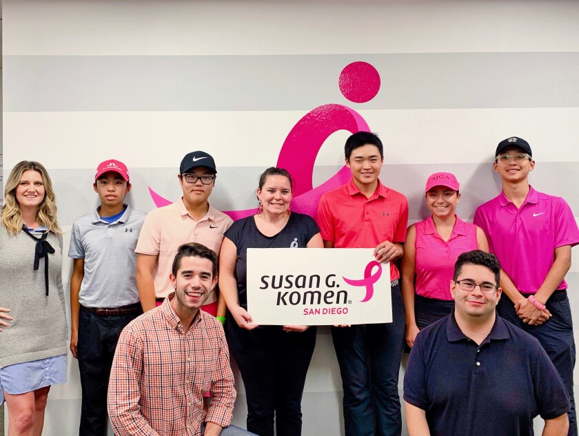 Check presentation of collected donation to Susan G. Komen San Diego on National Breast Cancer Day.