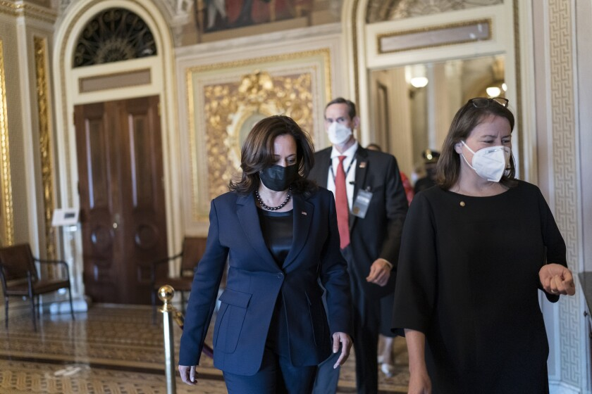 Kamala Harris walks toward the Senate chamber.