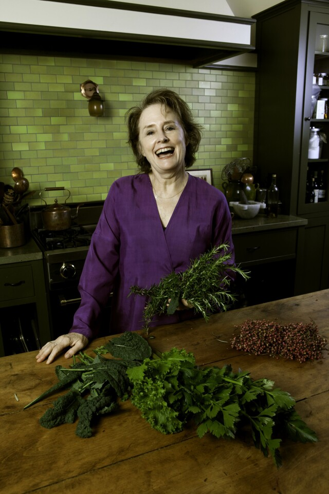 """Alice Waters, founder of Chez Panisse and vice president of Slow Food International, holds some fresh greens picked from her backyard garden at her North Berkeley home on Feb. 26, 2010. Waters revolutionized cooking in the 1970s and '80s with her philosophy that emphasizes fresh local ingredients inventively paired with recipes that are simple and delectable. Waters has written """"The Art of Simple Food,' """"Chez Panisse Vegetables"""" and """"Chez Panisse Menu Cookbook,"""" among others."""