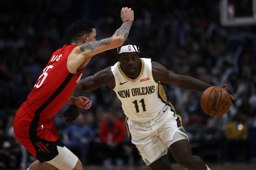 Pelicans guard Jrue Holiday drives against Rockets guard Austin Rivers during a game on Dec. 29, 2019, in New Orleans.