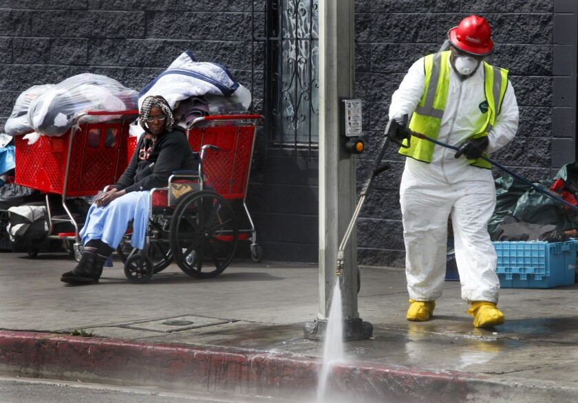 City sanitation crews carry out a cleanup on skid row.