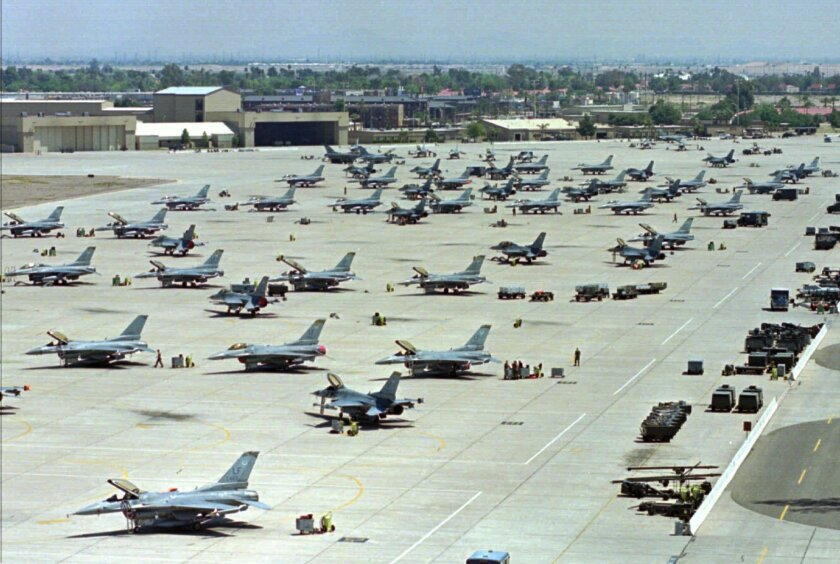 FILE - In this April 14, 1999, file photo, F-16 Fighting Falcons sit on the tarmac at Luke Air Force Base in Glendale, Calif. The U.S. Air Force says it will be distributing bottled water until at least April to thousands of residents and business owners near Luke Air Force Base in suburban Phoenix in the latest case of fire firefighting foam from a military base contaminating a nearby community's water supply. (AP Photo/Ken Levine, File)
