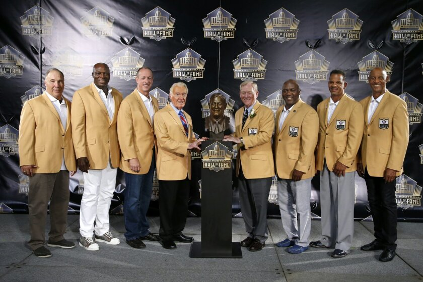 Bill Polian, right center, former president and general manager of the Buffalo Bills, poses with Bills who preceded him into the Pro Football Hall of Fame, during inductions Saturday, Aug. 8, 2015, in Canton, Ohio. From left are Joe Delamielleure, Bruce Smith, Jim Kelly, Marv Levy, Polian, Thurman