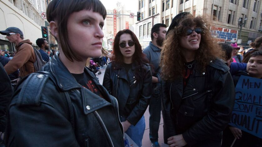 Bandmates Josette Maskin, Naomi McPherson and Katie Gavin of the electronic-inspired trio Muna at the women's march in Los Angeles.