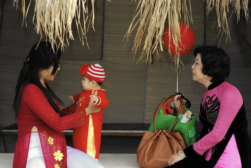 Celena Ngo, left, with son Kaycee Nguyen and mother Thanh Tran at the annual Tet Festival in Orange County.
