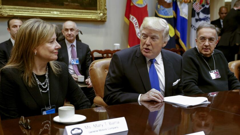 All smiles then, but not now: President Trump meets with General Motors CEO Mary Barra and the late Fiat Chrysler CEO Sergio Marchionne, right, in January 2017. Now he's angry that Barra is cutting jobs and closing factories, in part because of his policies.