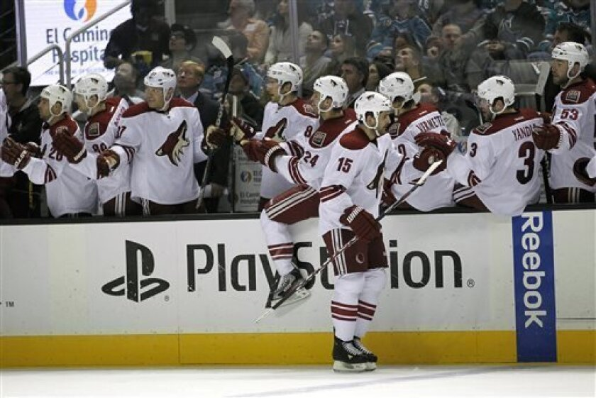 Phoenix Coyotes center Boyd Gordon (15) is congratulated by teammates after scoring a goal against the San Jose Sharks during the first period of an NHL hockey game in San Jose, Calif., Saturday, March 30, 2013. (AP Photo/Tony Avelar)