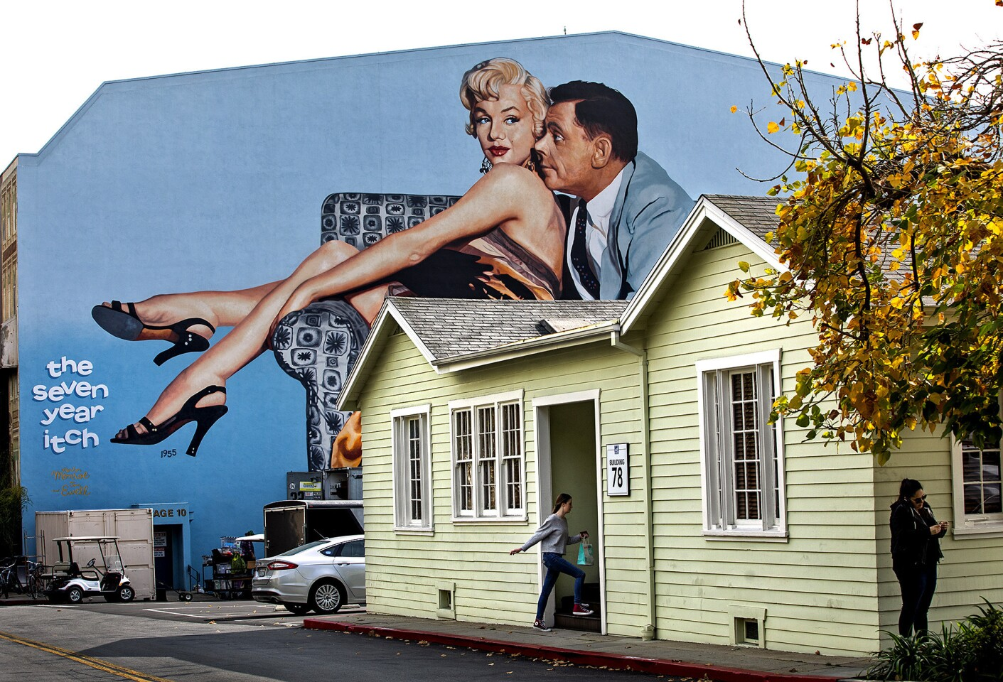 """An entire exterior wall of Stage 10 on the Fox Studios lot is covered by a mural depicting stars Marilyn Monroe and Tom Ewell from the 1955 comedy """"The Seven Year Itch."""""""