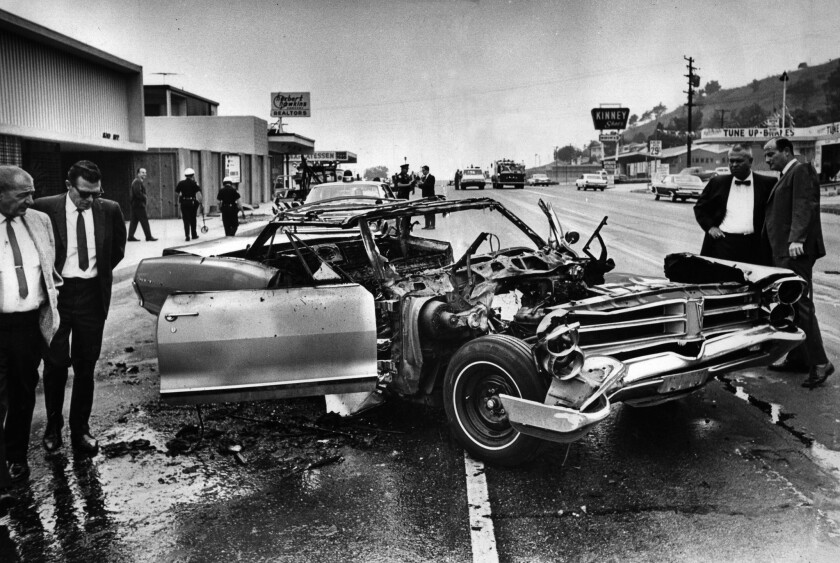 Sep. 18, 1967: Remains of auto on Atlantic Blvd., near Cadiz St. after the explosion of a time bomb.