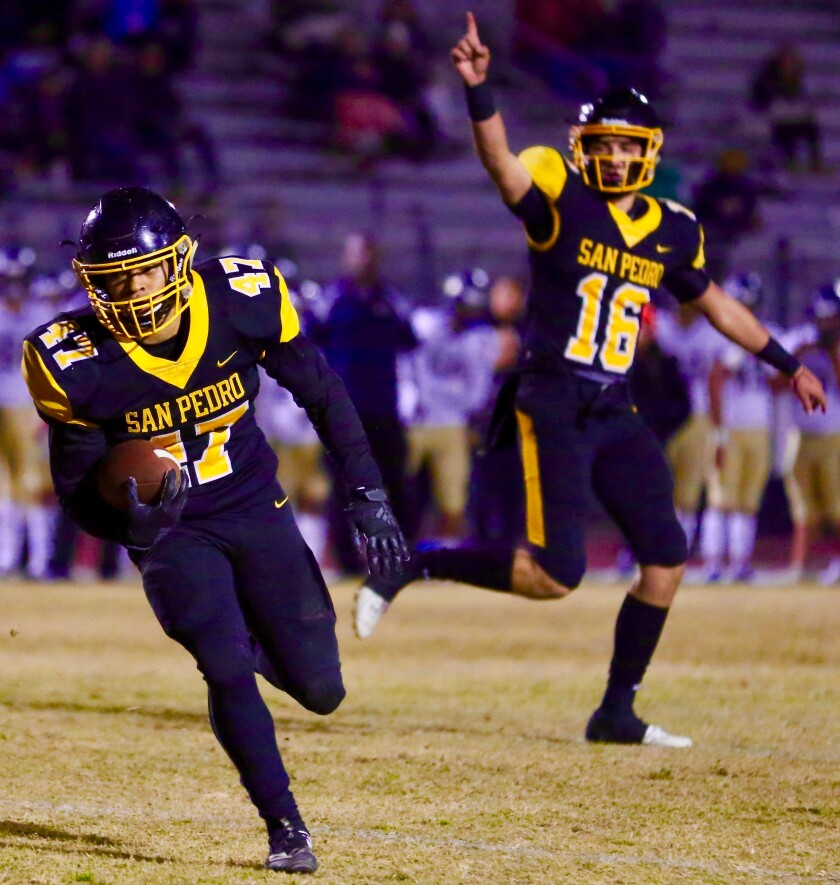 Josh Ward scores on a two-yard run to put San Pedro on the scoreboard first in Friday night's City Section Open Division semifinal against Birmingham on Friday.