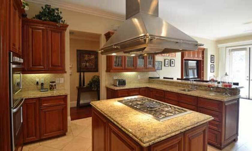 The house Kevin Eastman is selling has an updated kitchen.
