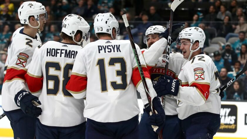 Florida Panthers' Frank Vatrano (72) is congratulated by teammates after scoring against the San Jose Sharks on Thursday in San Jose.