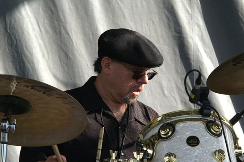 Paul Kimbarow is shown performing with Sha Na Na. The top San Diego drummer, who is recovering from a liver transplant, will be saluted July 21 at an all-star benefit concert at the Belly Up.