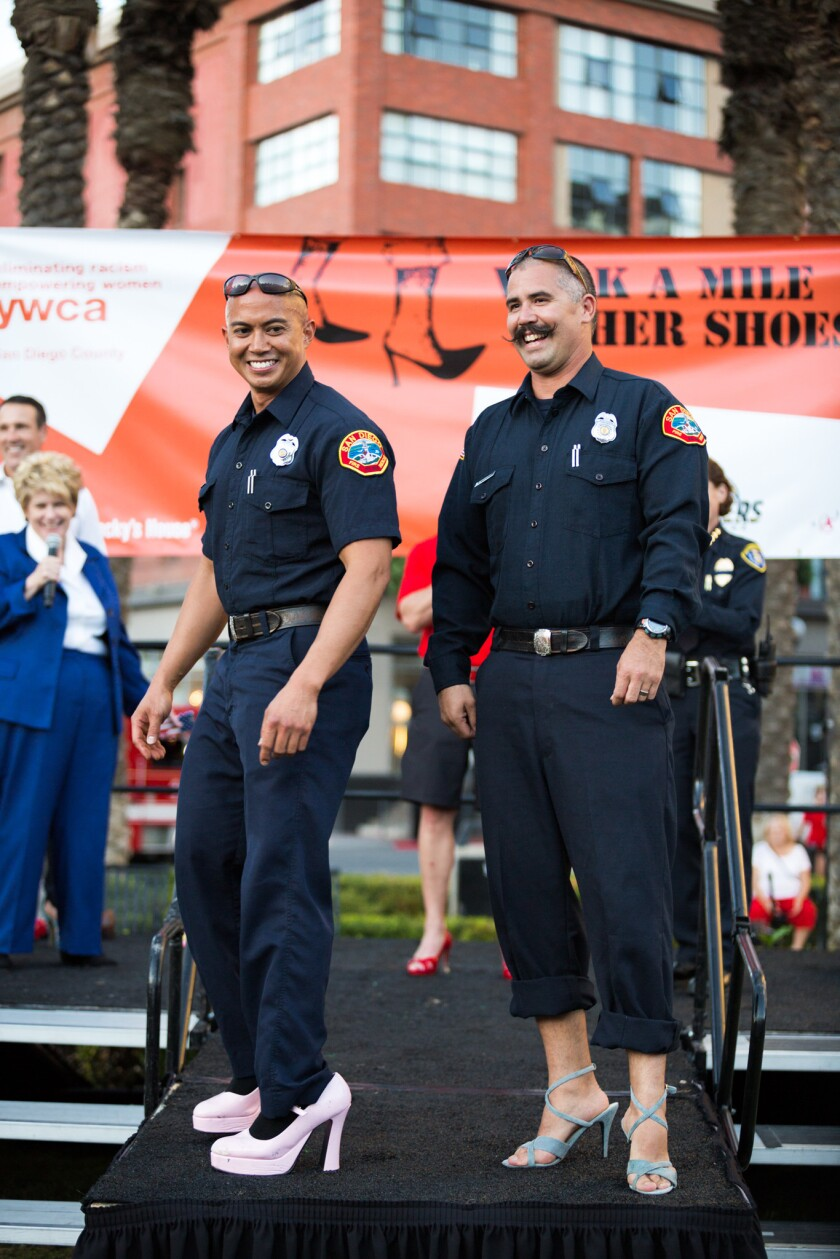 Men take on heels in the Walk A Mile in Her Shoes event.