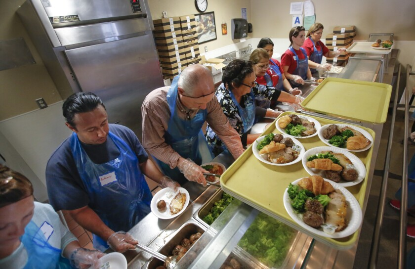 About 200 volunteers prepared and served 600 pounds of pork loin, 380 pounds of red potatoes, 150 pounds of broccoli, 150 pounds of salad, and 1,600 slices of cheesecake to about 1,400 people, mostly homeless, during the San Diego Rescue Mission's Easter dinner for the needy.