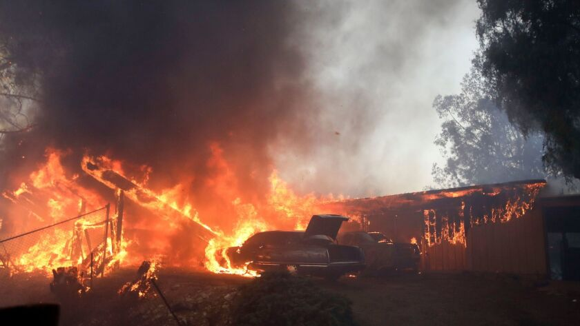 FILE - In this Tuesday, Dec. 5, 2017, file photo a home burns during the Creek Fire in the Lake View