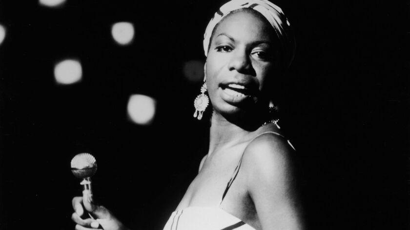 American singer Nina Simone performs in 1964.
