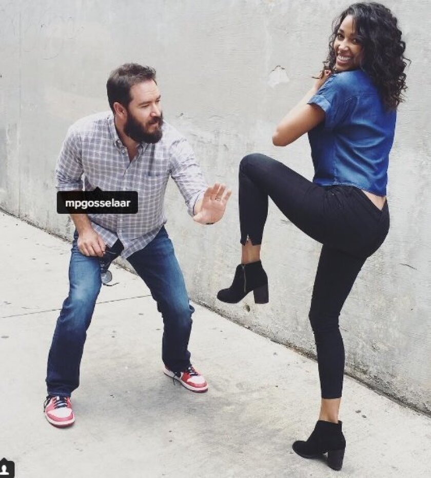 """Actress Kylie Bunbury practices her pitching technique coached by formerly clean-cut child star Mark-Paul Gosselaar, who plays the catcher for the new Fox TV show pilot, """"Pitch."""""""