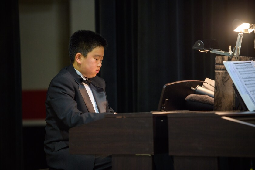 Jeremiah Cho playing piano at an SFCS band concert.jpg