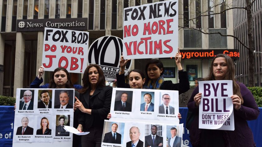 Protestors from the National Organization for Women of New York rally April 20, the day after Fox News cut ties with Bill O'Reilly.
