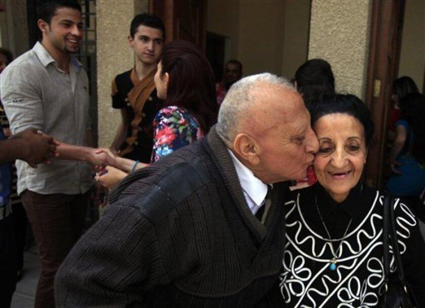 Iraqi Christians congratulate each other after Easter mass at Mar Youssif Chaldean Church in Baghdad, Iraq, Sunday, March 31, 2013. The Chaldean Church is an Eastern Rite church affiliated with the Roman Catholic Church. (AP Photo/ Karim Kadim)
