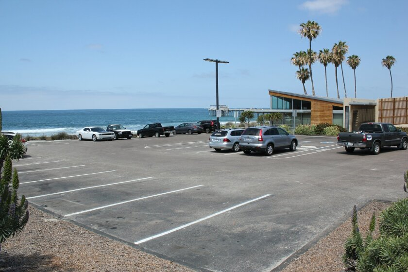 The parking lot at Scripps Seaside Forum is largely empty early Monday afternoon, April 20. The public may park in lots P002 and P003 after paying an hourly rate at a centrally located kiosk.