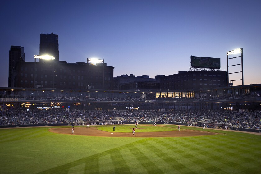 FILE - In this May 21, 2015, file photo, the St. Paul, Minn., skyline is visible beyond CHS Field as the St. Paul Saints hold their baseball season opener against the Fargo-Moorhead RedHawks at the new stadium. Major League Baseball went through with its plan to cut to 120 farm teams. As part of the reorganization, the Saints, which had been an independent team, will become the Triple-A team of the Minnesota Twins. (Aaron Lavinsky/Star Tribune via AP, File)