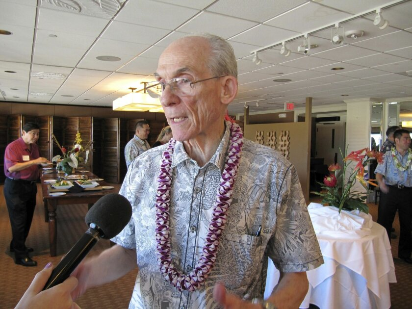 File- This photo taken Jan. 22, 2016, shows Thirty Meter Telescope Executive Director Ed Stone talking to reporters in Honolulu after participating in a Chamber of Commerce Hawaii panel on the future of Mauna Kea. A group building one of the world's largest telescopes wants to start construction no