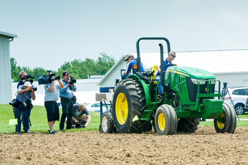 Members of the local media record a hemp planting on Tuesday afternoon at the University of Kentucky Spindletop Research Farm in Lexington, Ky.