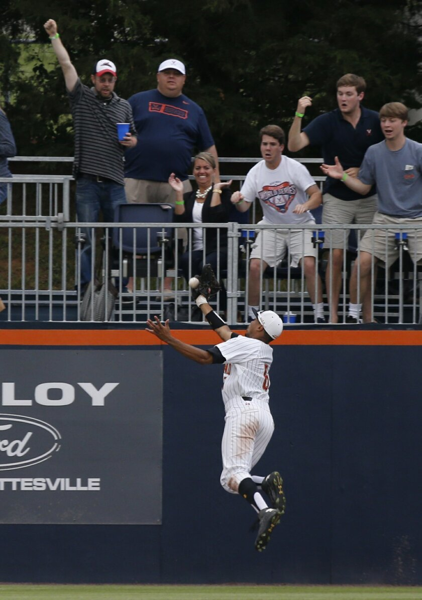 Maryland outfielder Lamonte Wade (6) drops a ball at the wall during the eighth inning of a super regional of the NCAA college baseball tournament in Charlottesville, Va., Friday, June 5, 2015.  Virginia won the game 5-3.  (AP Photo/Steve Helber)