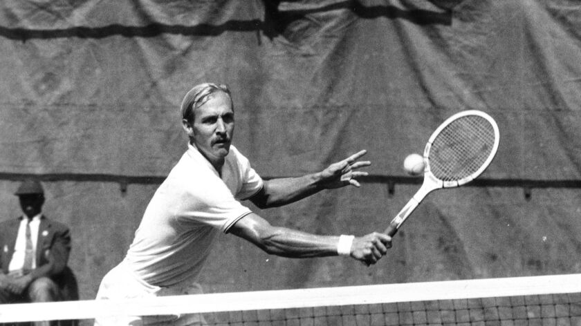 Stan Smith swats a backhand in the 1971 U.S. Open final against Czechoslovakia's Jan Kodes in Forest Hills, N.Y. Smith, now better known for his popular tennis sneakers, won in four sets.