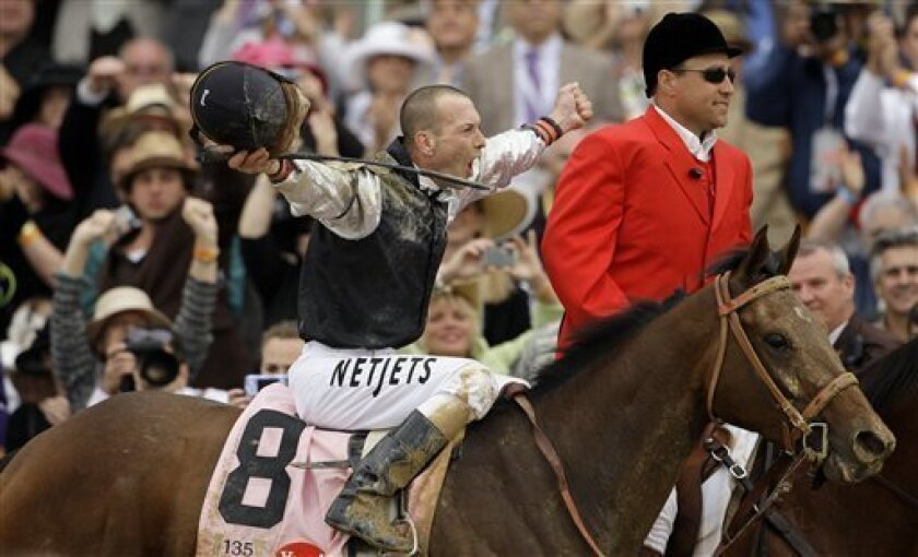 Calvin Borel riding Mine That Bird reacts after winning the 135th Kentucky Derby horse race at Churchill Downs Saturday, May 2, 2009, in Louisville, Ky. (AP Photo/Rob Carr)