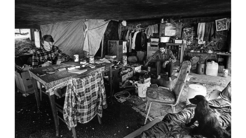 Nov. 21, 1985: Don Culshaw, 24, left, and Bernard Acquin, 39, in makeshift housing underneath a freeway.