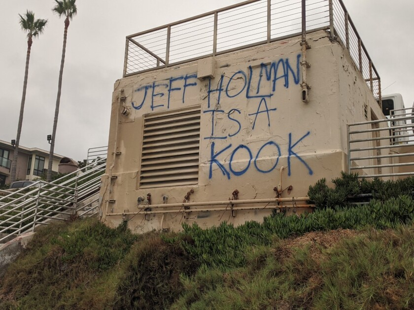 Jeff Holman saw his name painted on the pump house at La Jolla's Windansea Beach.