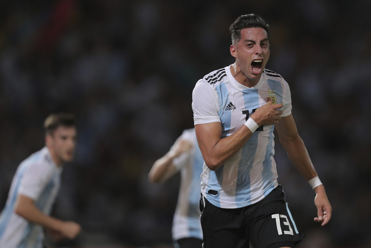 Argentina's Ramiro Funes Mori celebrates after scoring his team's first goal against Mexico during a friendly soccer match in Cordoba, Argentina, Friday, Nov. 16, 2018. (AP Photo/Nicolas Aguilera)
